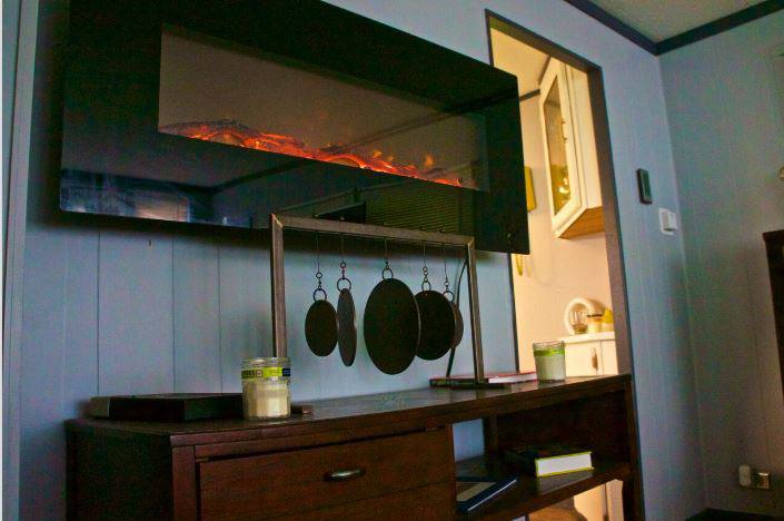 Affordable mobile home remodel - 1968 landola single wide goes retro (ventless fireplace on wall)