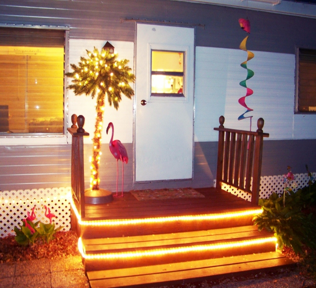 Mobile home at night with rope lights