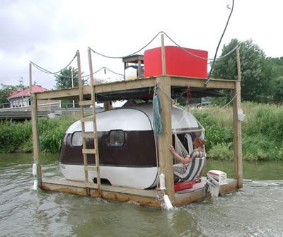 Mobile Home Ingenuity-camper in water