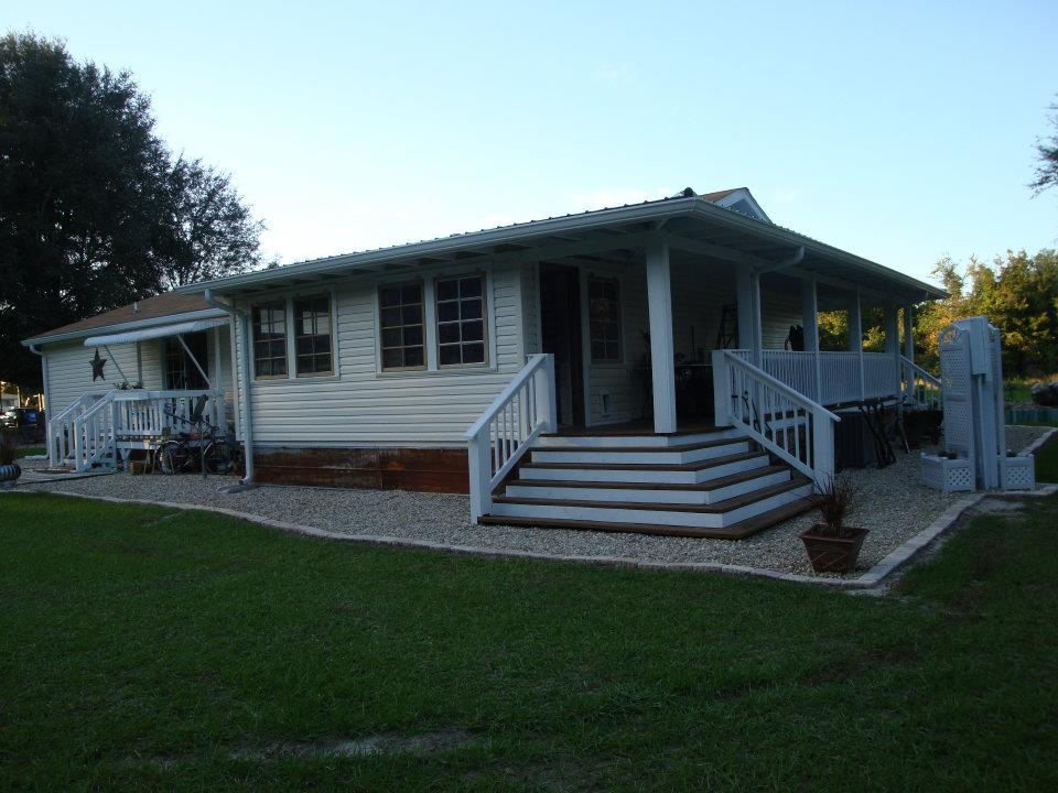 Dreamy double wide for Modular home with wrap around porch
