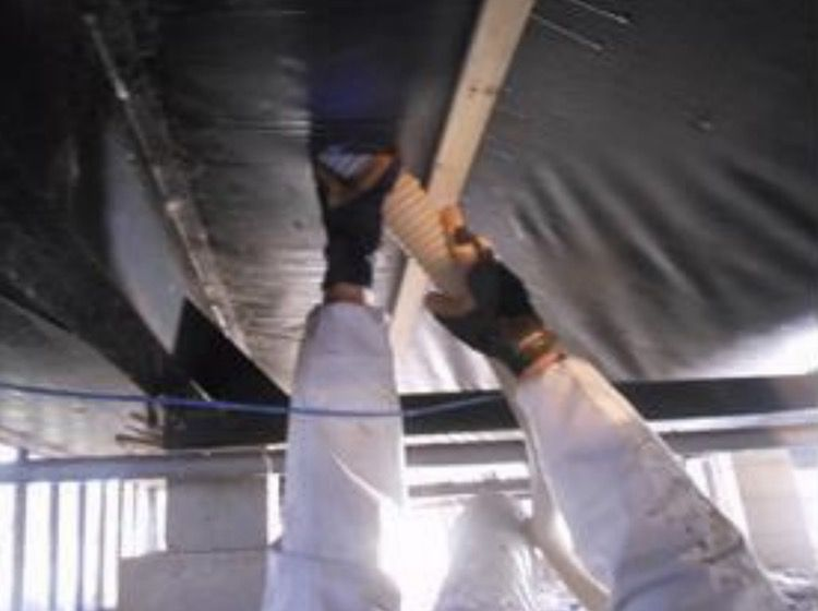 Blowing insulation into a mobile home underbelly 2