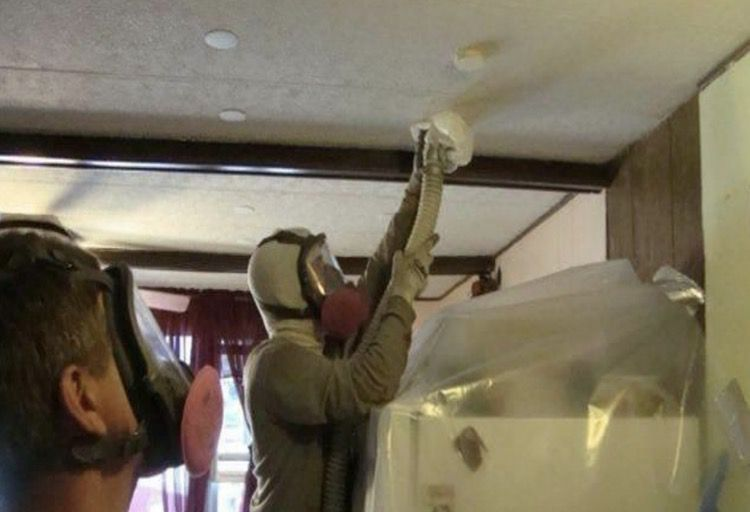 Blowing insulation insto the ceiling of a mobile home