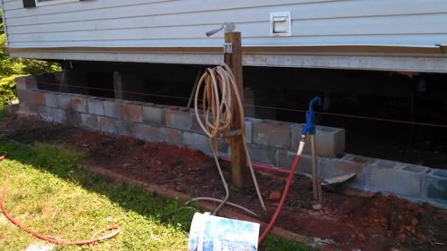 building a two-story addition onto a manufactured home - the home was set onto a basement too