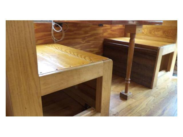 vintage buses-built in dining table with custom woodwork in 1997 Bluebird International bus