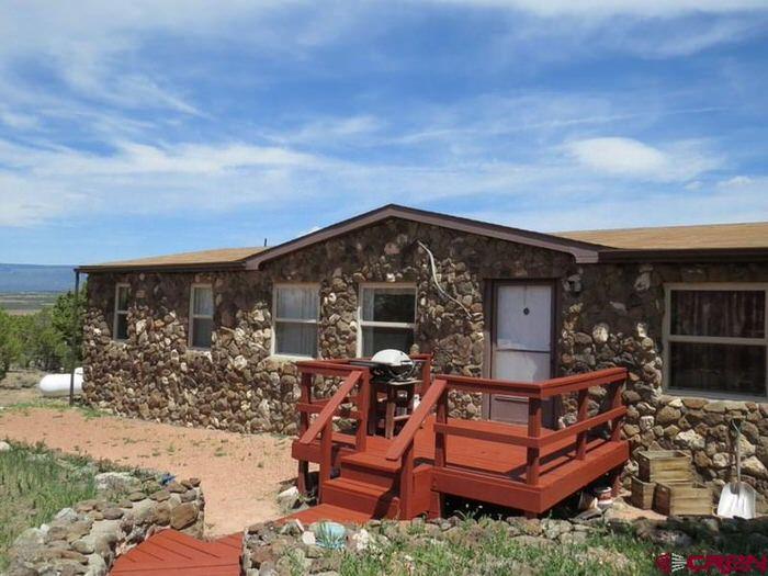 buying a mobile home in colorado-stone facade