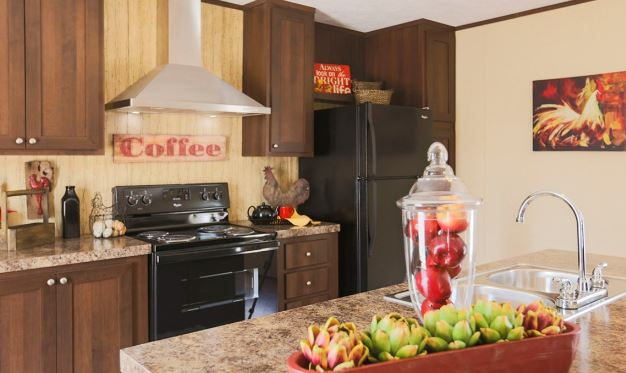 compare a shipping container home to a manufactured home - interior view of kitchen