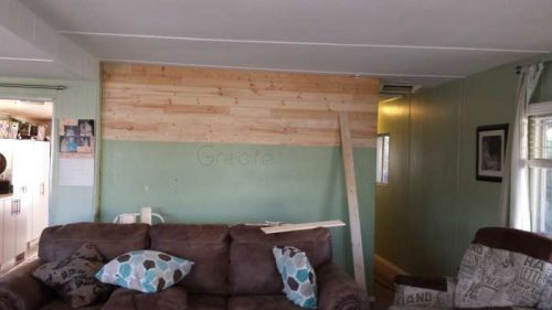 DIY mobile home transformation - installing shiplap on mobile home walls 2
