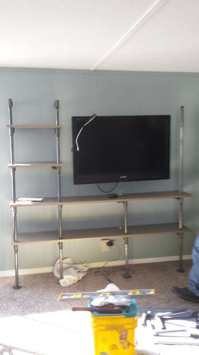 1968 DIY mobile home transformation - building a plumbing pipe entertainment center - during