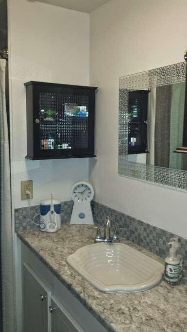 DIY mobile home transformation - sheet metal shower - before - sink
