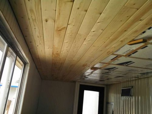 1968 DIY mobile home transformation - installing shiplap to the ceiling of a home