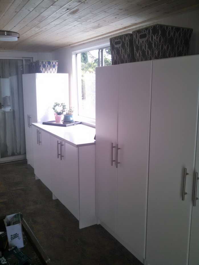 complete mobile home transformation - storage /office room makeover - storage cabinets installed