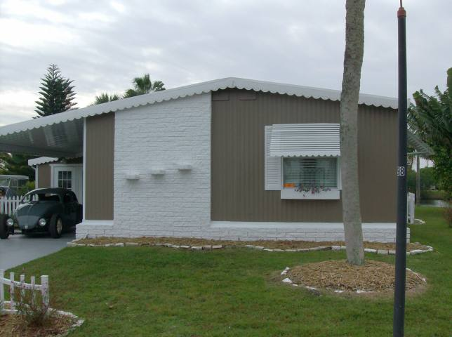 Check out this cool coastal cottage double wide mobile for Cottage style manufactured homes