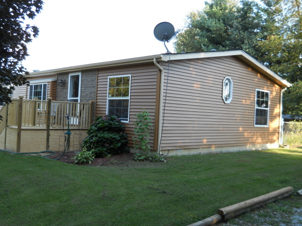double wide exterior remodel - after