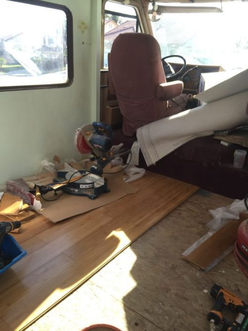 Gloria's 1987 motorhome RV makeover - new flooring being laid