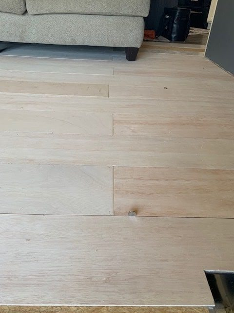 DIY farmhouse flooring project - plywood has been laid and ready for paint