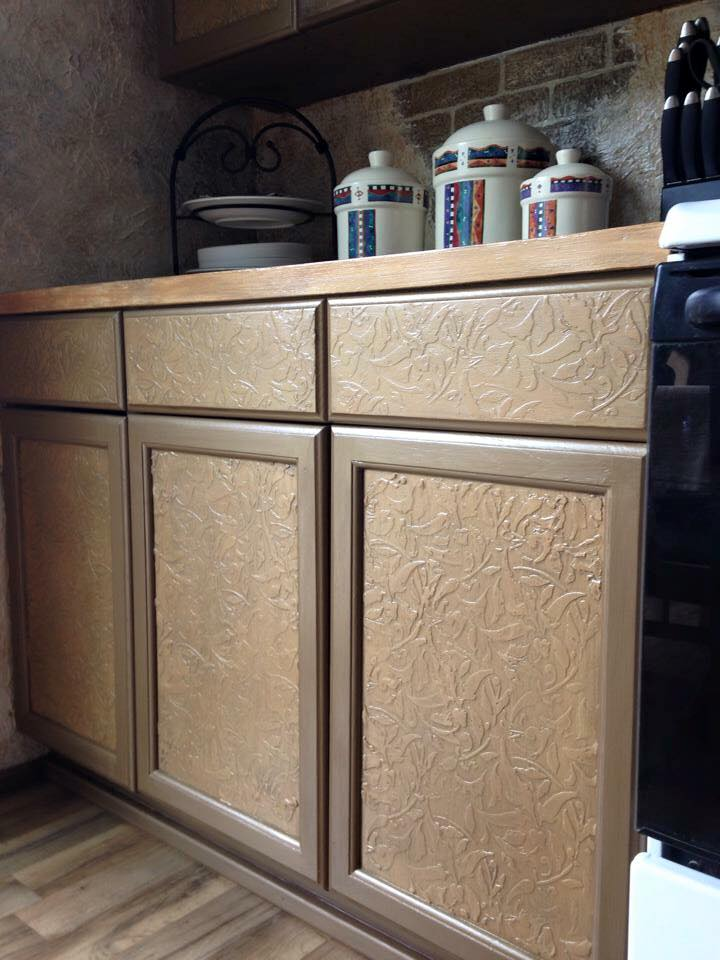 kitchen cabinets with raised stencil treatment and faux painting