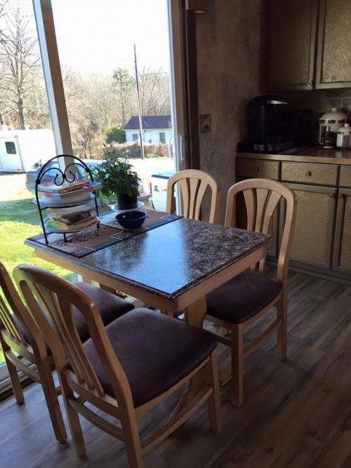 Cute kitchen and dining table after mobile home renovation