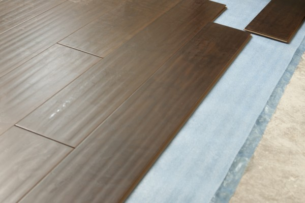 Man installing new laminate wood flooring mobile and for Manufactured hardwood flooring