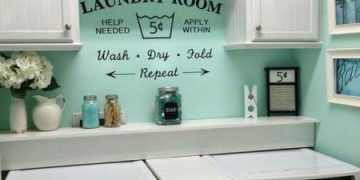 Wall decor and paint brighten this laundry space.