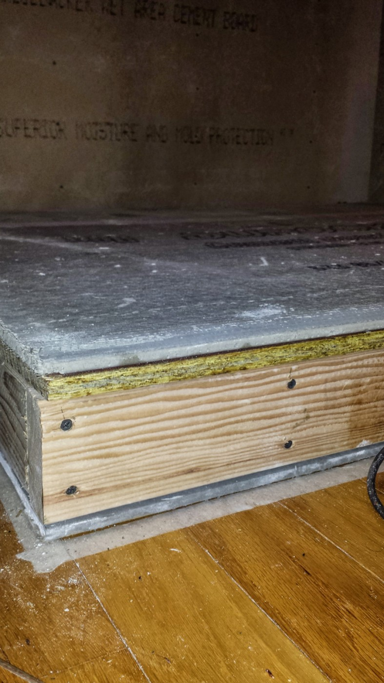 layers cement brd 1-2 in plywood 2x4 frame sheet rock