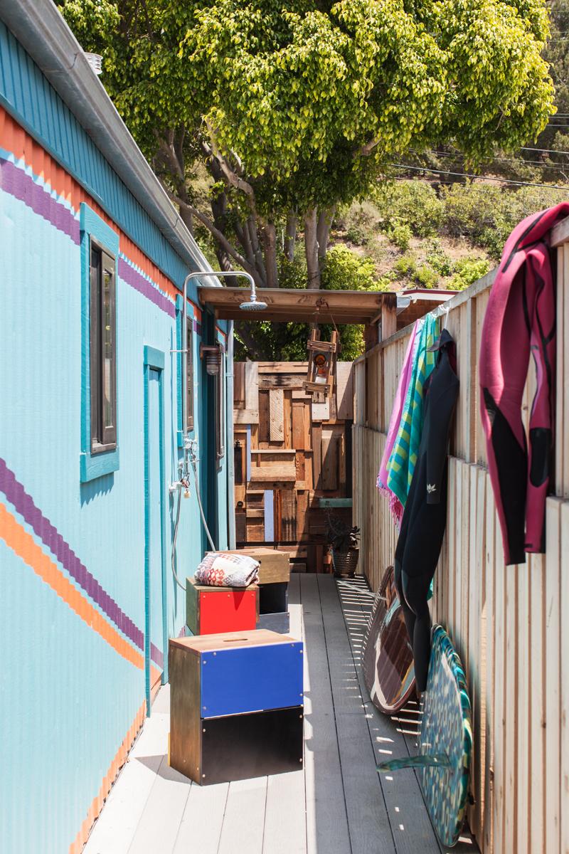 colorful Malibu mobile home makeover - metal siding is painted