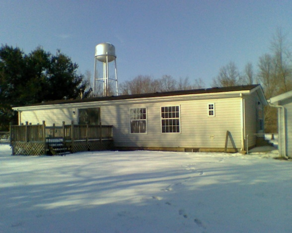 manufactured home before backyard makeover