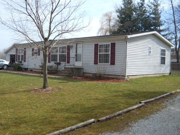 manufactured home before exterior remodel