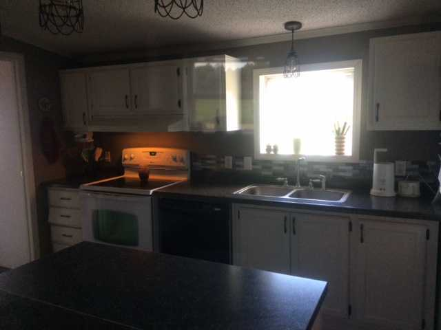 after manufactured home kitchen update on 600 budget - new lighting