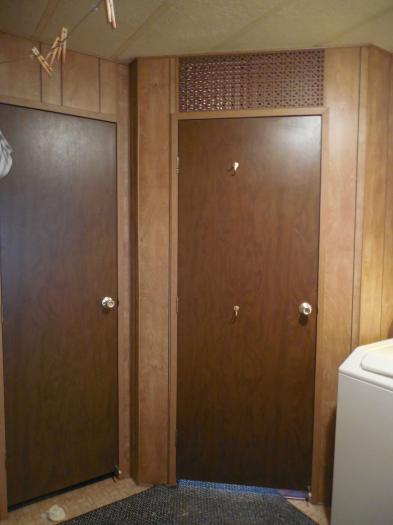manufactured home makeover -storage closet in laundry room before