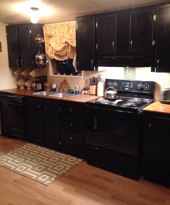 Farmhouse Inspired Manufactured Home Makeover (painted kitchen cabinets black after)