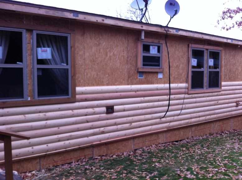Rustic Cabin Manufactured Home Remodel - new siding being installed