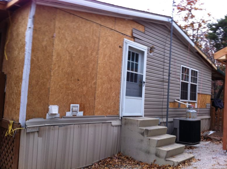 manufactured home remodel - old siding being removed