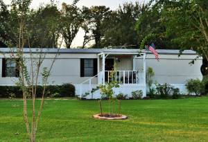 Mobile home exterior gets new paint (1)