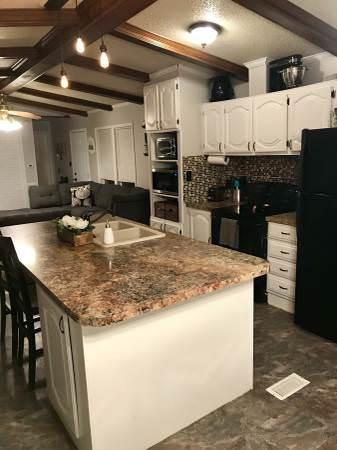 Open floor plan in a single wide remodel-built in for kitchen