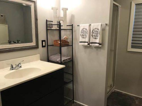 Open floor plan in a single wide remodel-master bath