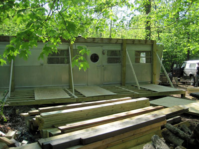 screened in porch being built onto a 1955 Spartan