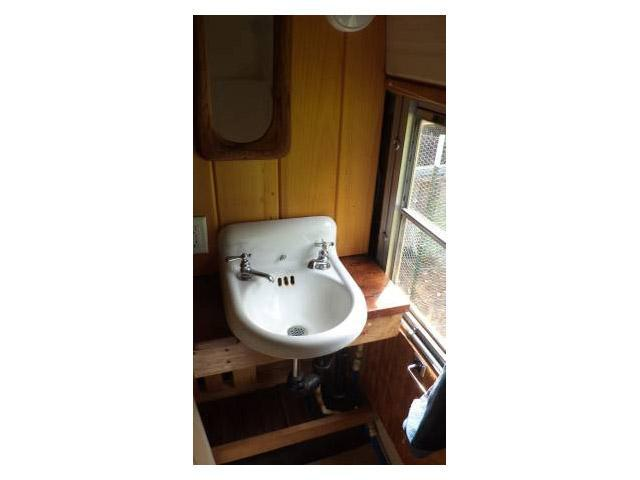 vintage buses-sink in 1997 Bluebird International full length school bus to mobile home conversion