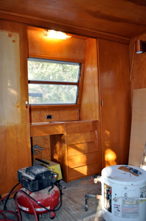 staining the birch paneling on Spartan renovation