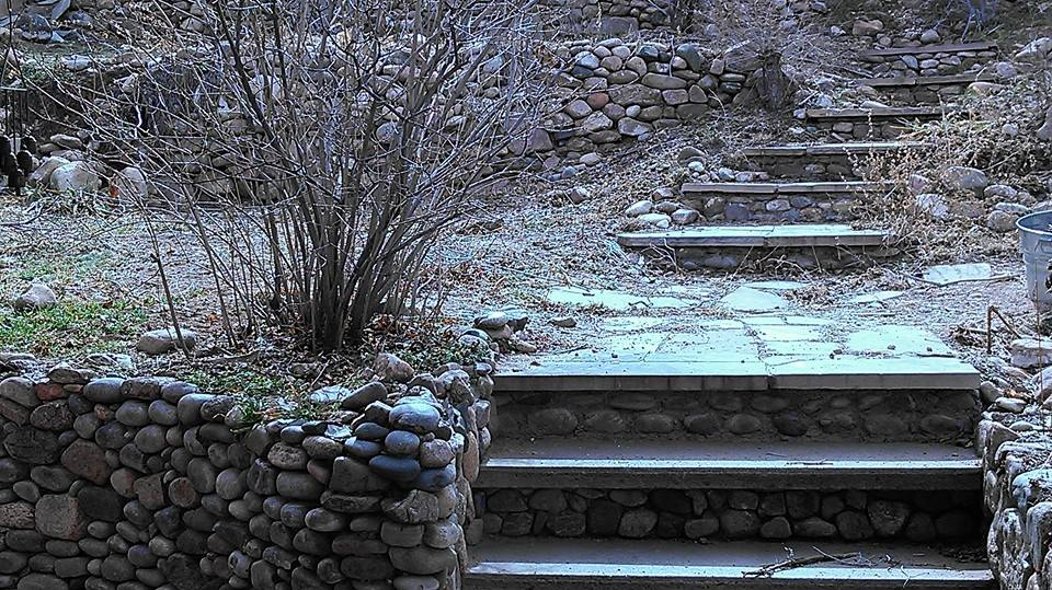 stone walkway at sante fe vintage single wide mobile home remodel