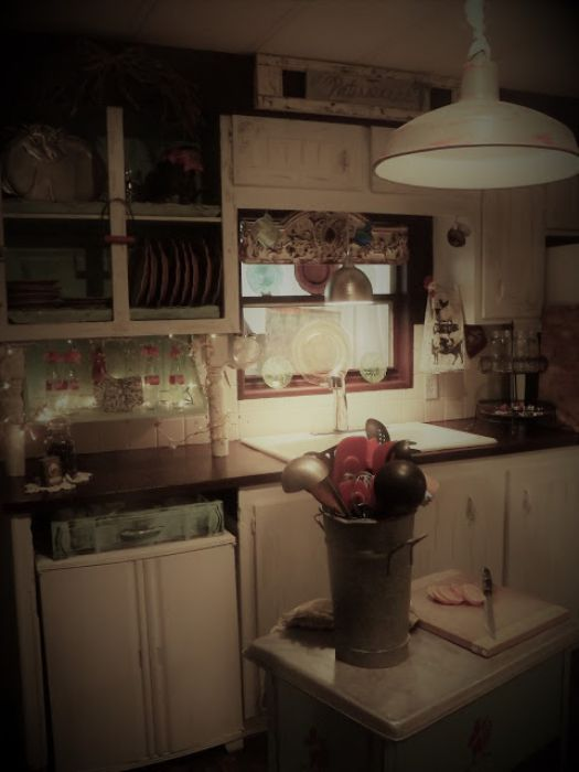 vintage farmhouse decor in a mobile home kitchen - sink and cabinets