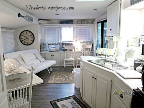 Mobile home decorating beach style makeover for Kitchen colors with white cabinets with wagon wheel wall art