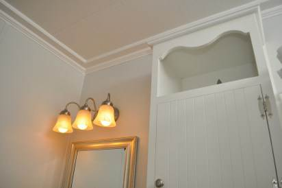 Awesome trim installed in mobile home bathroom remodeled