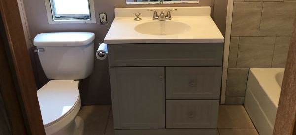 updated single wide-bathroom after 2