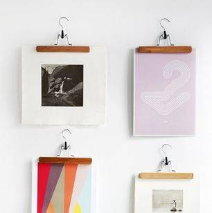 use clothes hangers to hang diy wall art