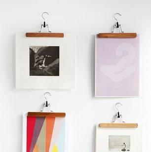 use clothes hangers to hang diy wall art