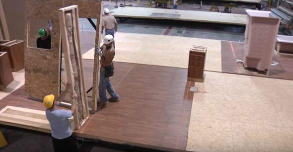 walls being installed over flooring in manufactured home construction factory (2)