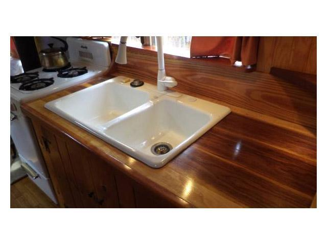 vintage buses-wood counter top in 1997 Bluebird International bus conversion