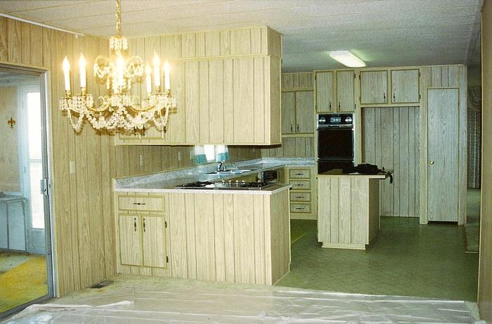 Wood paneling in mobile home kitchen