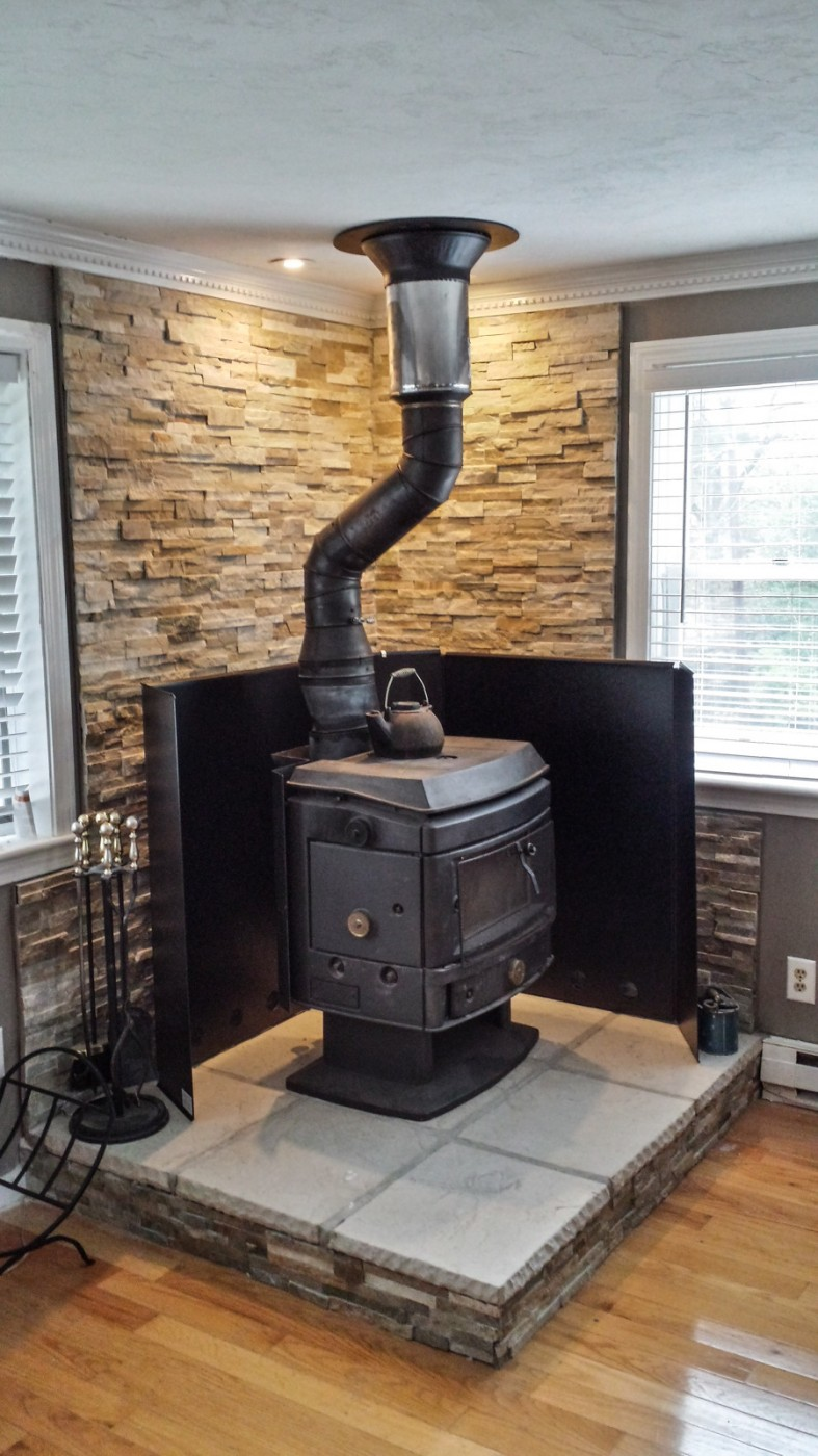 wood stove installed with heat shield